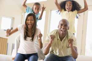 African American family is happy in a new home